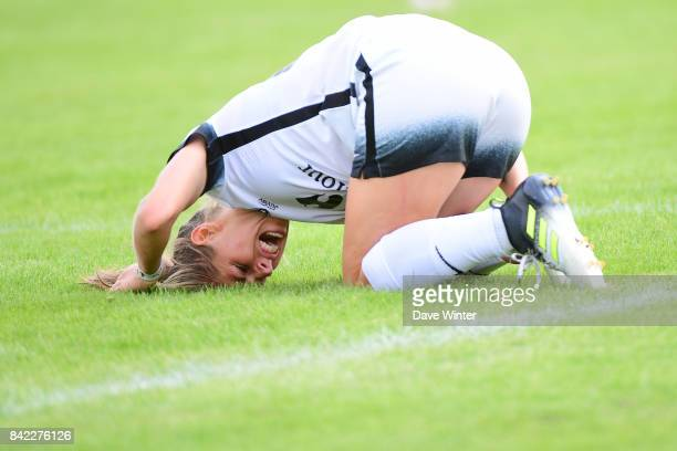 Camille Catala of Paris FC goes down injured during women's Division 1 match between FC Fleury 91 and Paris FC on September 3 2017 in Fleury Merogis...