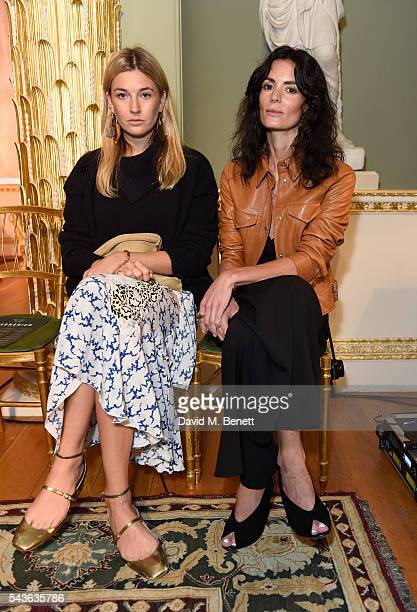 Camille Charrier and Hedvig Opshaug attend the Creatures of the Wind Resort 2017 collection and runway show presented by Farfetch at Spencer House on...