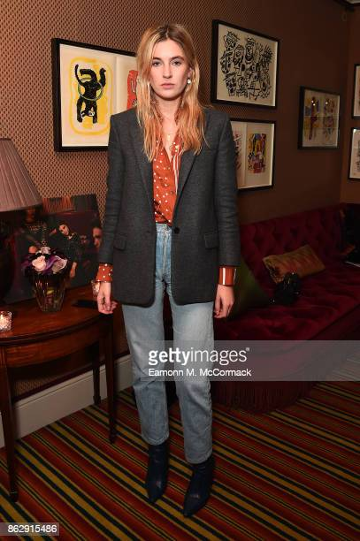 Camille Charriere attends the Julia RestoinRoitfeld Christmas Edit for Warehouse launch at Mark's Club on October 18 2017 in London England