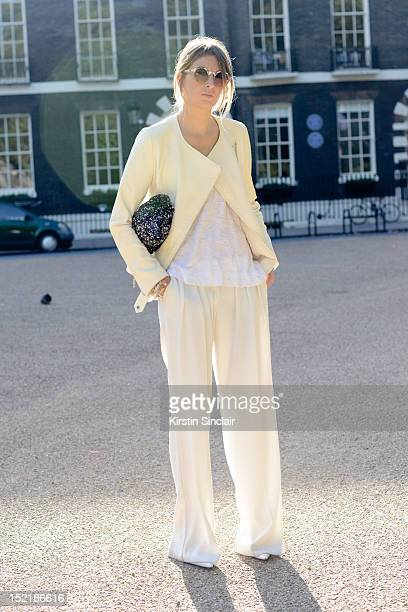 Camille Charriere fashion writer and blogger wearing Mango shoes and trousers, Zara jacket and clutch bag, Asos Sunglasses on day 3 of London Fashion...