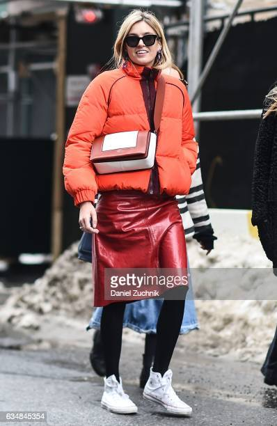 Camille Charriere is seen wearing a Ganni orange jacket at the Tibi show during New York Fashion Week Women's Fall/Winter 2017 on February 11 2017 in...