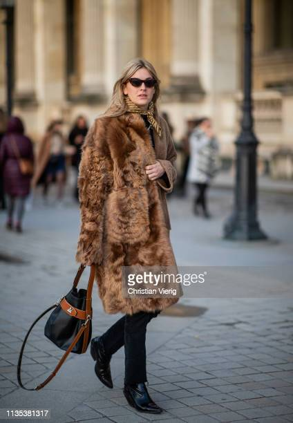 Camille Charriere is seen wearing brown coat bag outside Louis Vuitton during Paris Fashion Week Womenswear Fall/Winter 2019/2020 on March 05 2019 in...