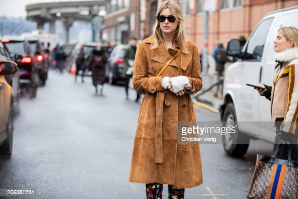 Camille Charriere is seen wearing brown wild leather jacket outside Coach during New York Fashion Week Fall / Winter on February 11 2020 in New York...