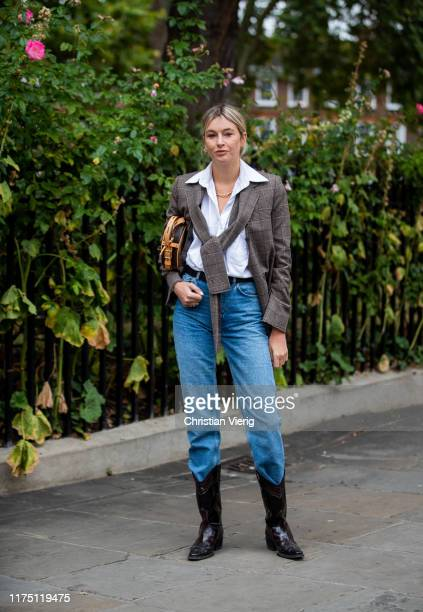 Camille Charriere is seen wearing checkered blazer, denim jeans, Louis Vuitton bag outside Erdem during London Fashion Week September 2019 on...
