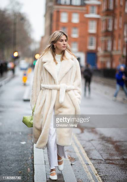 Camille Charriere is seen wearing creme white teddy coat outside JW Anderson during London Fashion Week February 2019 on February 18 2019 in London...
