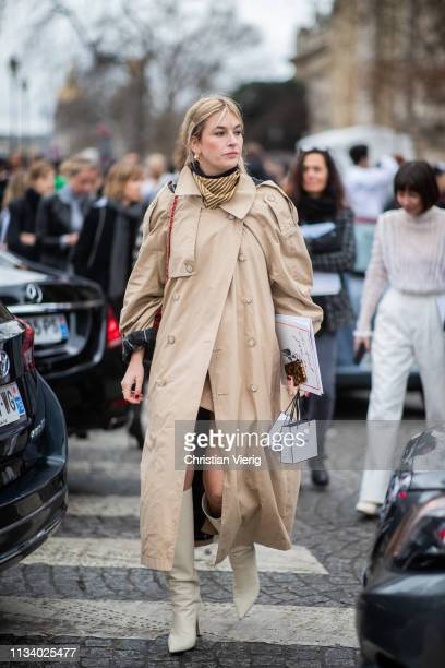 Camille Charriere is seen wearing trench coat outside Chanel during Paris Fashion Week Womenswear Fall/Winter 2019/2020 on March 05 2019 in Paris...