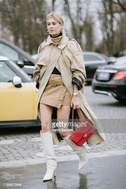 Camille Charriere poses with a Chanel bag after the Chanel show at the Grand Palais during Paris Fashion Week Womenswear Fall Winter 2019/2020 on...
