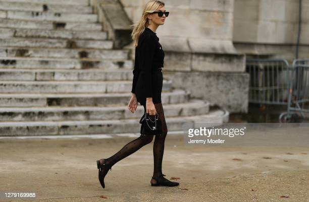 Camille Charriere seen wearing a complete Chanel look outside Chanel during Paris Fashion Week - Womenswear Spring Summer 2021 : Day Nine on October...