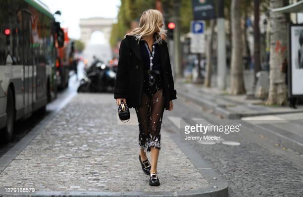 Camille Charriere seen wearing a complete Miu Miu look outside Miu Miu during Paris Fashion Week - Womenswear Spring Summer 2021 : Day Nine on...