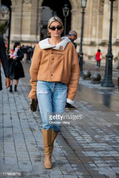 Camille Charriere seen wearing beige shearling jacket, ripped denim jeans, brown boots outside Louis Vuitton during Paris Fashion Week Womenswear...