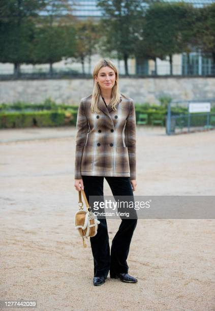 Camille Charriere seen wearing blazer, Dior bag outside Dior during Paris Fashion Week - Womenswear Spring Summer 2021 : Day Two on September 29,...