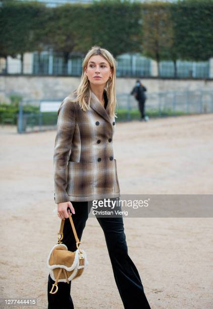 Camille Charriere seen wearing blazer Dior bag outside Dior during Paris Fashion Week Womenswear Spring Summer 2021 Day Two on September 29 2020 in...