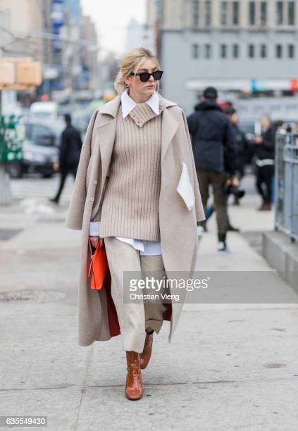 Camille Charriere wearing a beige knit beige wool coat cropped pants outside Michael Kors on February 15 2017 in New York City