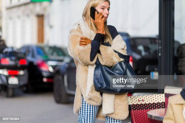 Camille Charriere wearing a teddy coat brown leather gloves checked pants outside Dior on January 23 2017 in Paris Canada