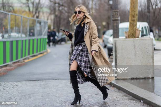 Camille Charriere wearing a trench coat outside Maison Margiela on March 1 2017 in Paris France