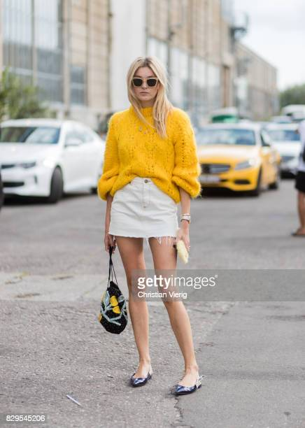 Camille Charriere wearing a yellow knit, mini skirt outside Ganni on August 10, 2017 in Copenhagen, Denmark.