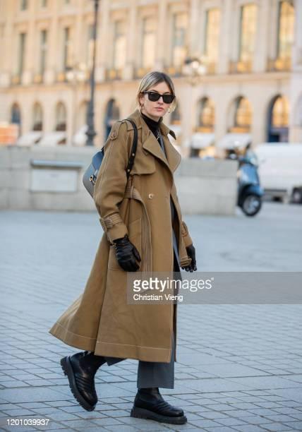 Camille Charriere wearing black bag, gloves Bottega Veneta, brown coat seen during Paris Fashion Week - Haute Couture Spring/Summer 2020 on January...