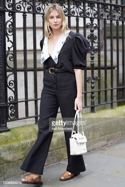 Camille Charriere wearing black trouser suit attends Erdem at National Portrait Gallery during London Fashion Week February 2020 on February 17 2020...