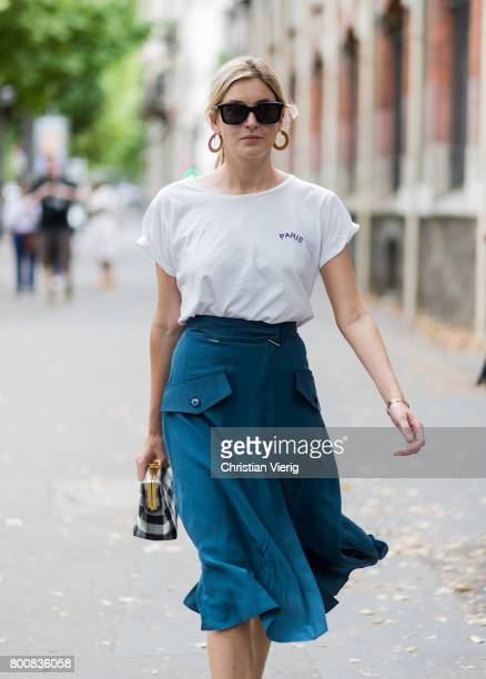 Camille Charriere wearing blue skirt white tshirt check bag outside Paul Smith during Paris Fashion Week Menswear Spring/Summer 2018 Day Five on June...