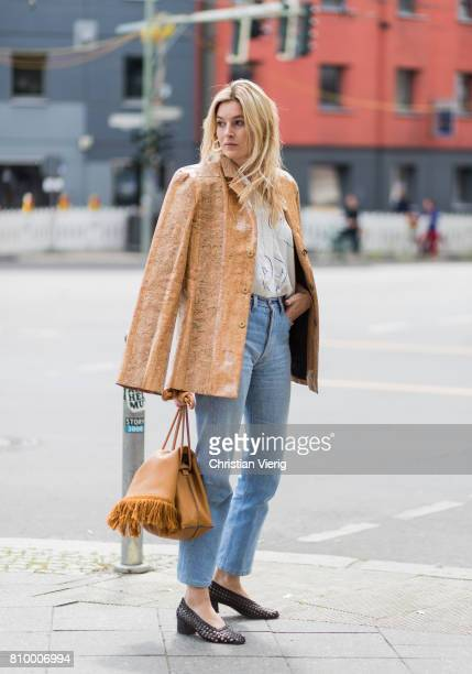 Camille Charriere wearing brown jacket cropped denim shoes brown bag white blouse during the MercedesBenz Fashion Week Berlin Spring/Summer 2018 at...