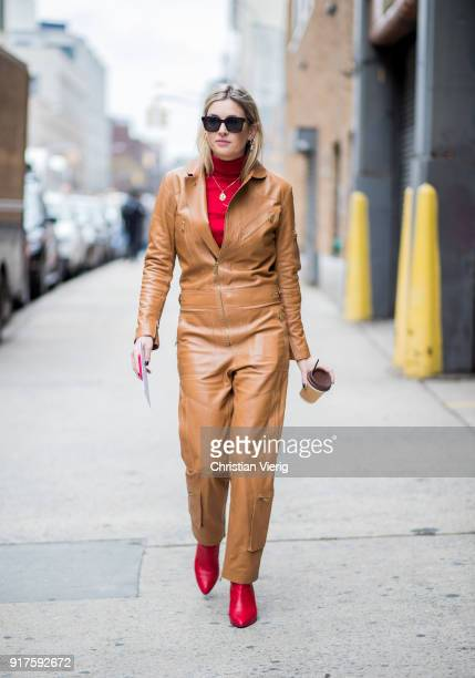 Camille Charriere wearing brown leather jumpsuit seen outside Ralph Lauren on February 12 2018 in New York City