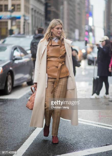 Camille Charriere wearing brown plaid pants brown leather jacket wool coat seen outside Sies Marjan on February 11 2018 in New York City