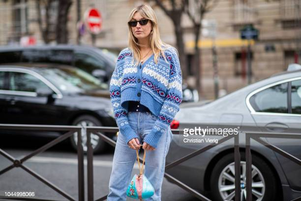 Camille Charriere wearing cardigan denim jeans is seen outside Miu Miu during Paris Fashion Week Womenswear Spring/Summer 2019 on October 2 2018 in...
