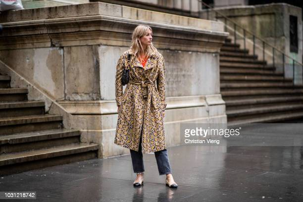 Camille Charriere wearing coat with snake print is seen outside Proenza Schouler during New York Fashion Week Spring/Summer 2019 on September 10 2018...