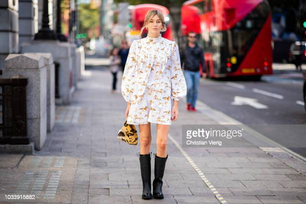 Camille Charriere wearing dress with print black boots leopard print bag is seen outside ALEXACHUNG during London Fashion Week September 2018 on...