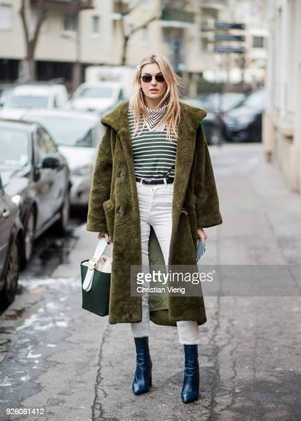 Camille Charriere wearing green teddy coat is seen outside Carven on March 1 2018 in Paris France