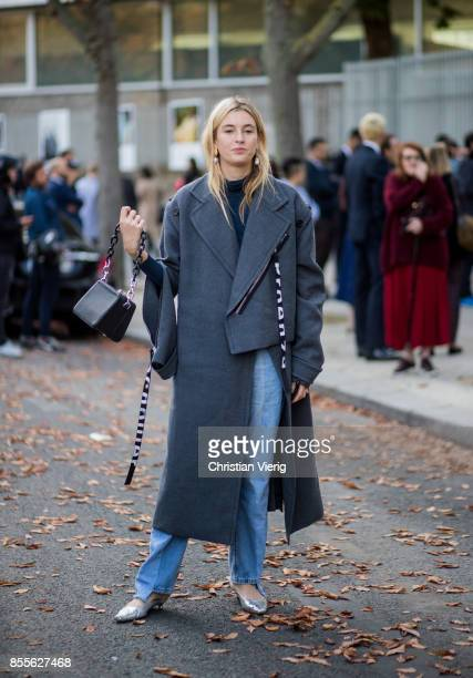 Camille Charriere wearing grey wool coat is seen outside Loewe during Paris Fashion Week Spring/Summer 2018 on September 29 2017 in Paris France