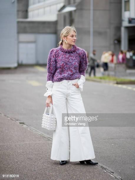 Camille Charriere wearing purple turtleneck white wide leg pants outside Designers Remix during the Copenhagen Fashion Week Autumn/Winter 18 on...
