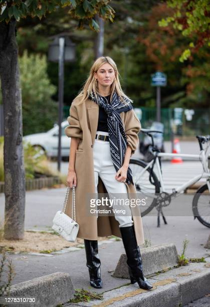 Camille Charriere wearing scarf beige wool coat white pants outside Hermes during Paris Fashion Week Womenswear Spring Summer 2021 Day Six on October...