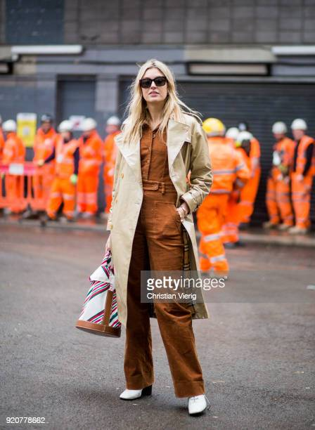 Camille Charriere wearing trench coat Carven bag brown bag buton shirt seen outside Marques Almeida during London Fashion Week February 2018 on...