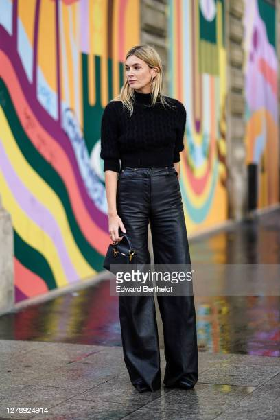 Camille Charriere wears a black turtleneck pullover black leather flared pants a Vuitton bag outside Louis Vuitton during Paris Fashion Week...