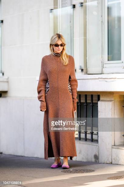 Camille Charriere wears a brown dress a white bag purple shoes outside Chloe during Paris Fashion Week Womenswear Spring/Summer 2019 on September 27...