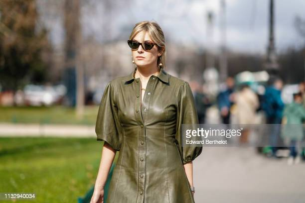 Camille Charriere wears earrings a green leather dress sunglasses outside Paco Rabanne during Paris Fashion Week Womenswear Fall/Winter 2019/2020 on...