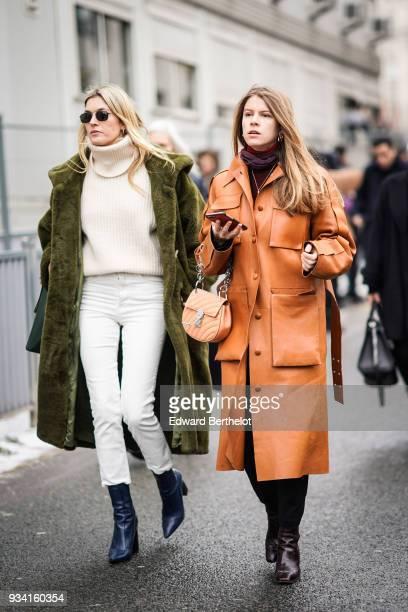 Camille Charriere wears sunglasses an offwhite turtleneck white skinny pantsan olive green sheepskin coat a green handbag petrol blue boots a guest...