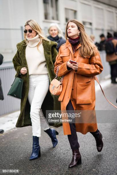 Camille Charriere wears sunglasses an offwhite turtleneck white skinny pantsan olive green sheepskin coat a green handbag petrol blue boots a guest...