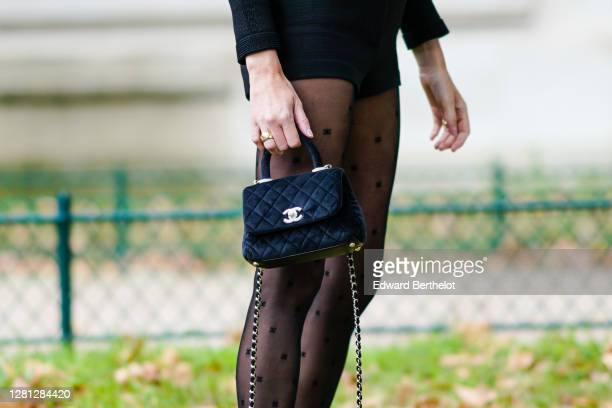 Camille Charriere wears tights with printed polka dots, a Chanel bag, outside Chanel, during Paris Fashion Week - Womenswear Spring Summer 2021, on...