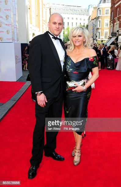 Camille Coduri and guest arriving for the 2014 Arqiva British Academy Television Awards at the Theatre Royal Drury Lane London