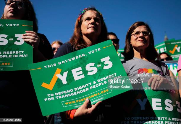 Camille Ernst center and Joanne Hooker right hold signs for a Yes on 3 rally in Boston's Copley Square on Sep 16 2018 Question 3 on the state ballot...