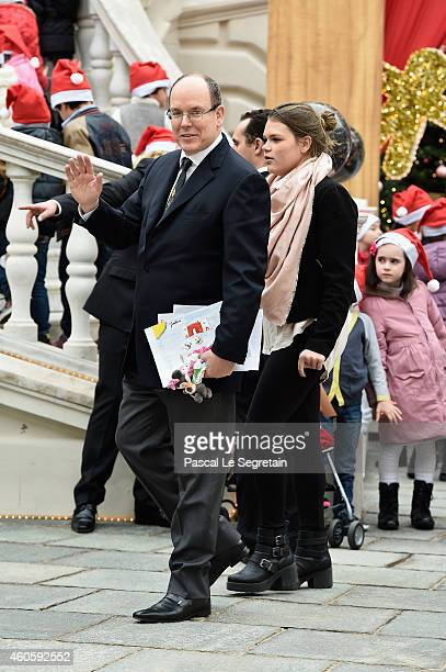 Camille Gottlieb and Prince Albert II of Monaco arrive in the courtyard of the Monaco Palace to attend the Christmas gifts distribution on December...