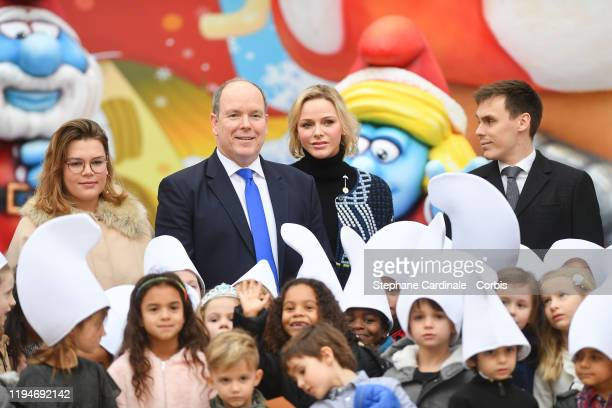 Camille Gottlieb Princess Charlene of Monaco Prince Albert II of Monaco and Louis Ducruet attend the Christmas Gifts Distribution At Monaco Palace on...