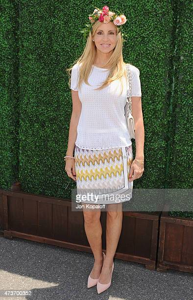Camille Grammer arrives at the Ovarian Cancer Research Fund's 2nd Annual Super Saturday LA at Barker Hangar on May 16 2015 in Santa Monica California