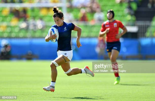 Camille Grassineau of France breaks through to score the opening try during the Women's Rugby Sevens Pool B match between France and Spain on Day 1...