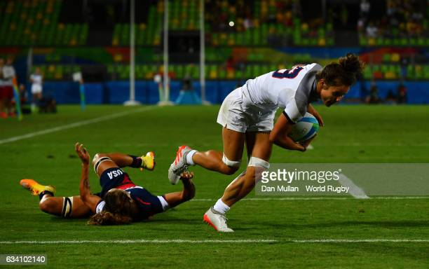 Camille Grassineau of France holds off Ryan Carlyle of the United States to score a try during the Women's Rugby Sevens placing match between France...