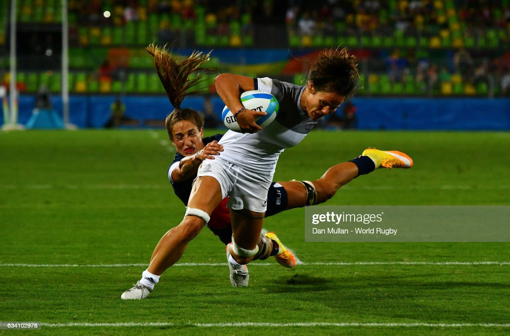Camille Grassineau of France holds off Ryan Carlyle of the United States to score a try during the Women's Rugby Sevens placing match between France and the United States on day 3 of the Rio 2016 Olympic Games at Deodoro Stadium on August 8, 2016 in Rio de Janeiro, Brazil.