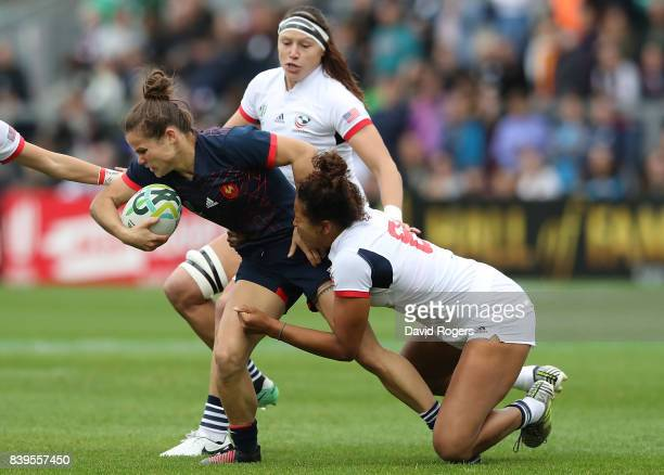 Camille Grassineau of France is tackled by Jordan Grey of The USA during the Women's Rugby World Cup 2017 Third Place Match between France and The...