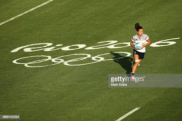 Camille Grassineau of France runs with the ball during a Women's Pool B rugby match between France and Kenya on Day 1 of the Rio 2016 Olympic Games...